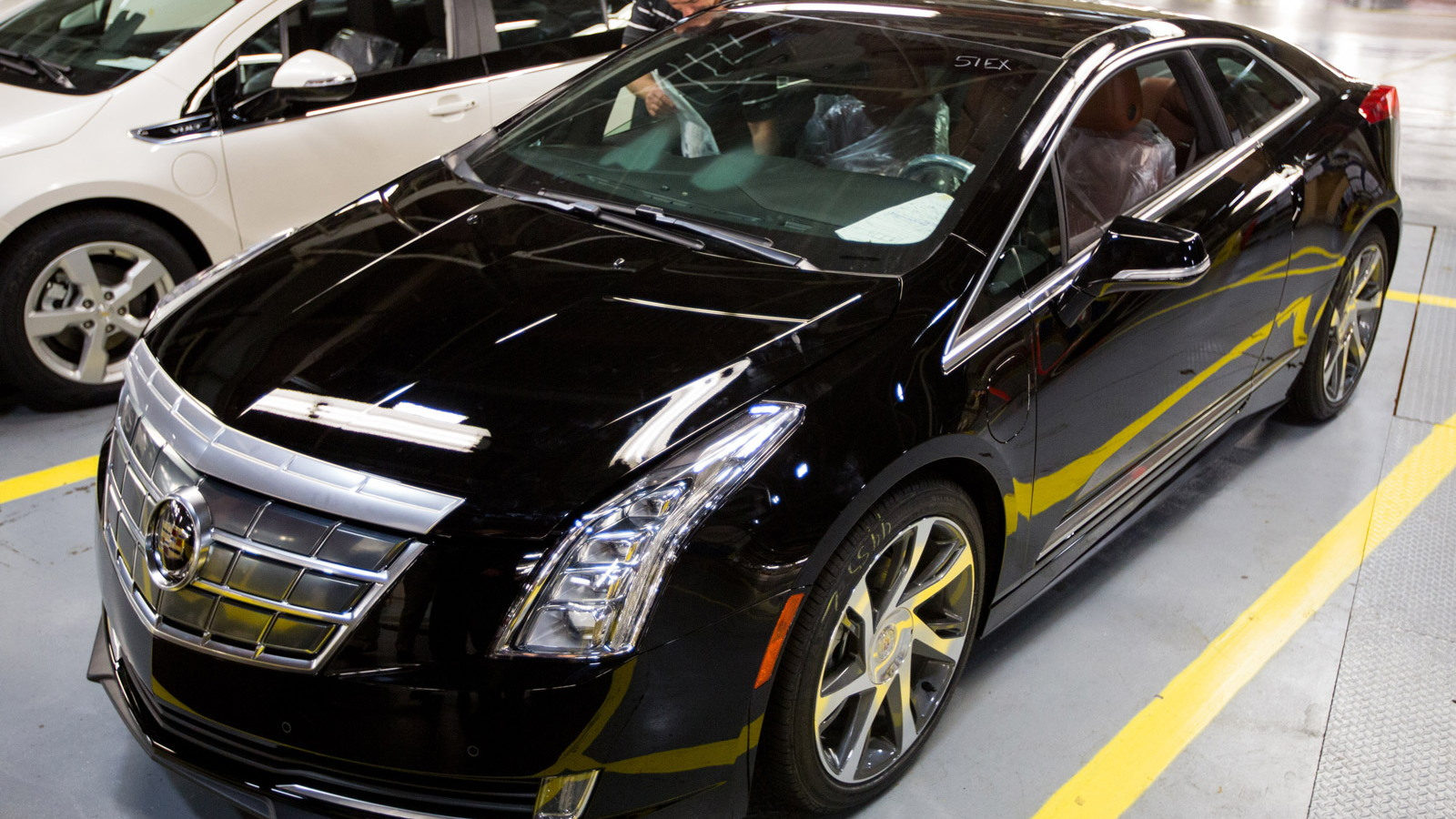 IndyCar driver Simona de Silvestro at the 2014 Cadillac ELR production line