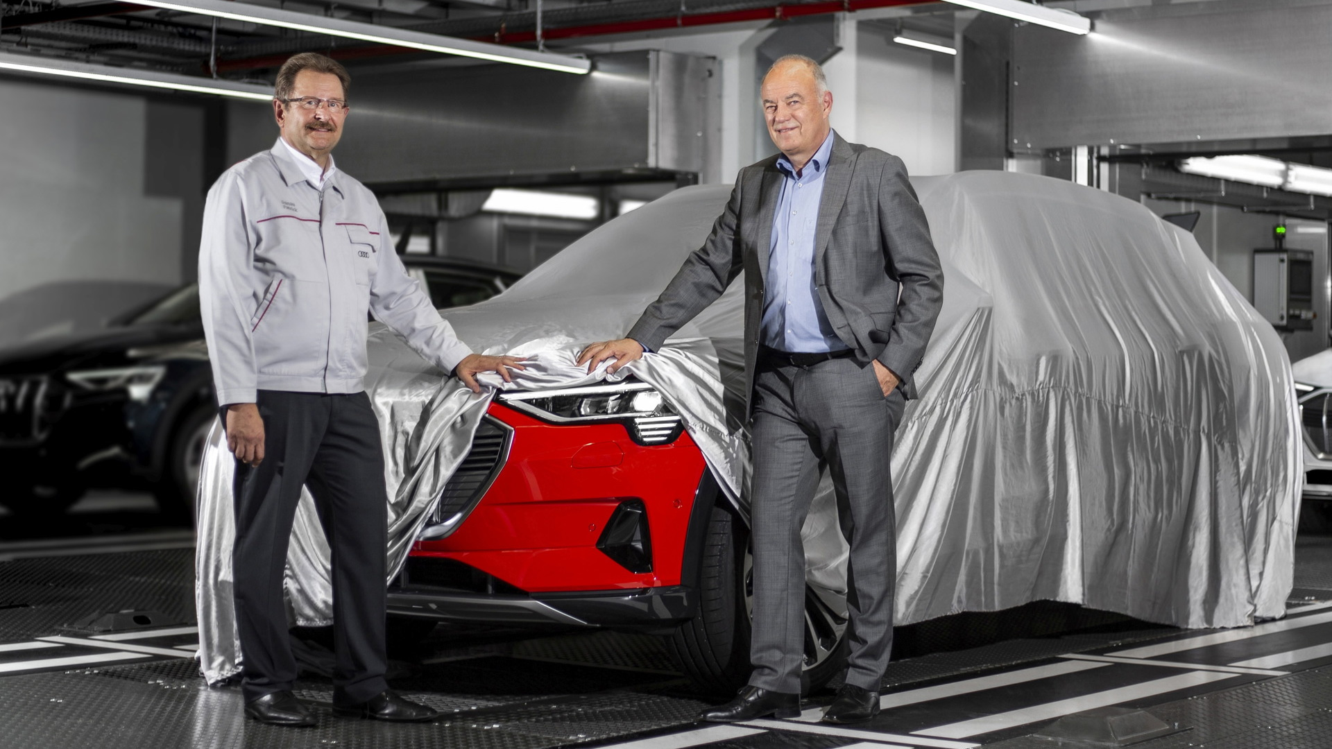 Audi management inspect first e-tron electric SUV off the line at plant in Brussels, Belgium