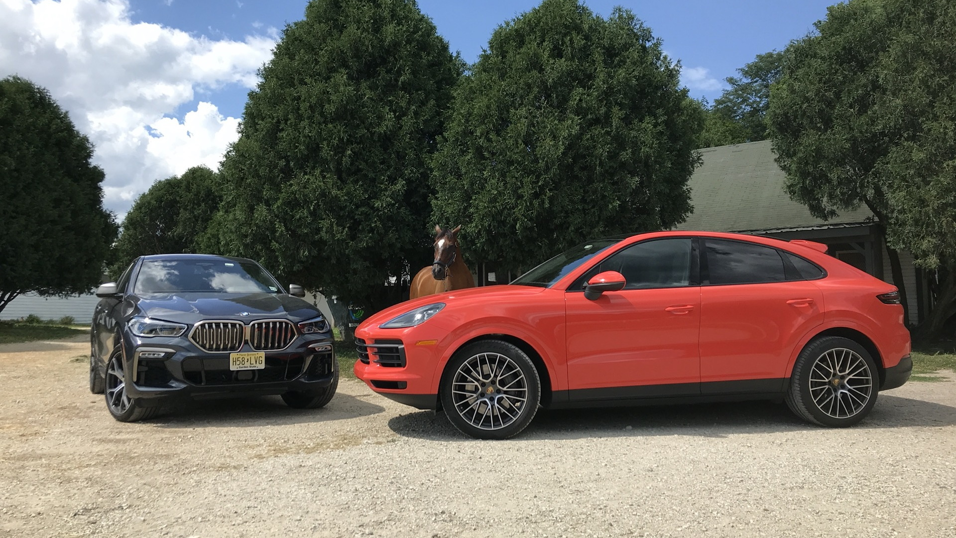2020 BMW X6 M50i, left, and 2020 Porsche Cayenne Coupe S, right