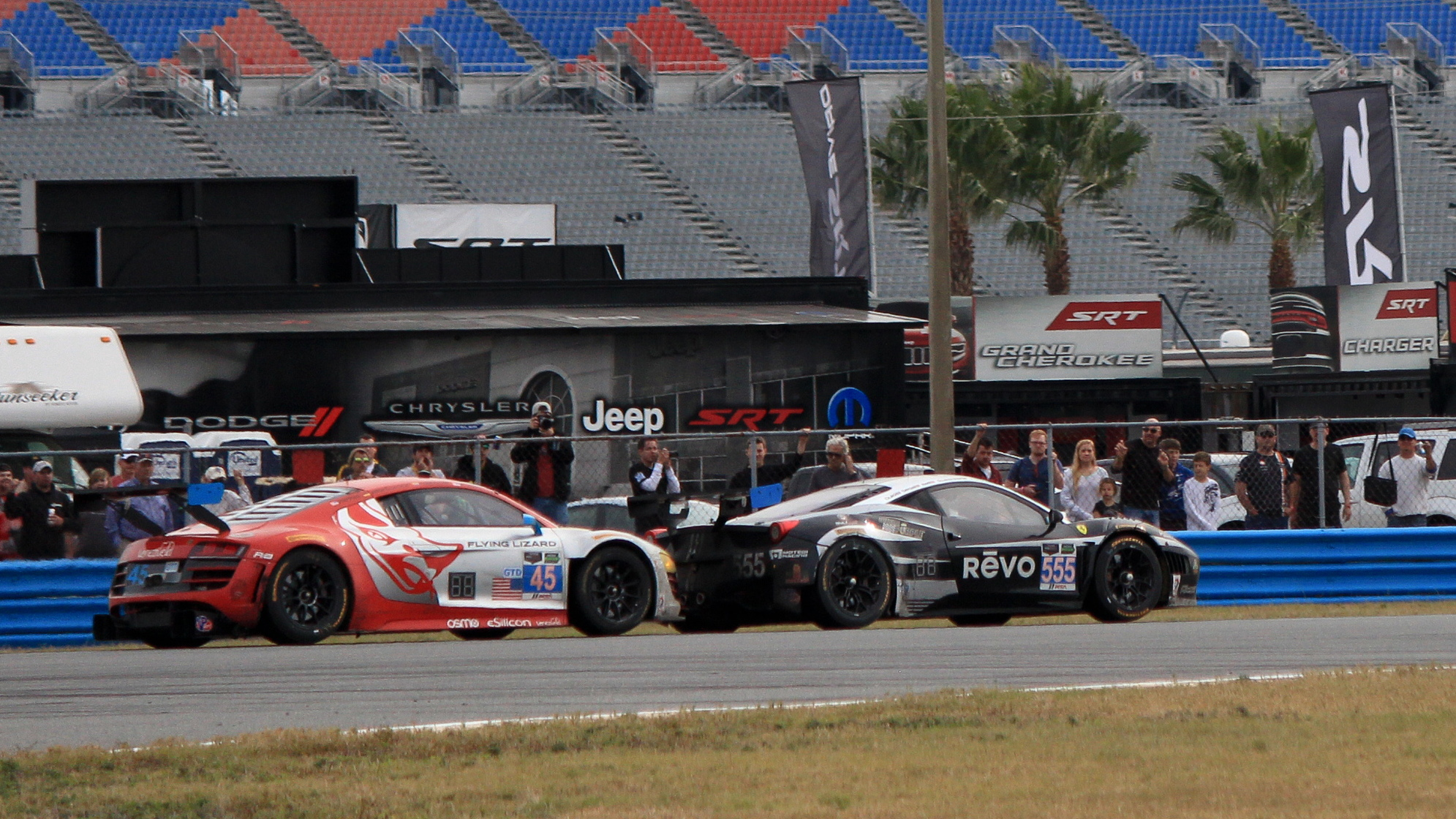Winkelhock an Guidi battle for position at the end of the 2014 Rolex 24 at Daytona