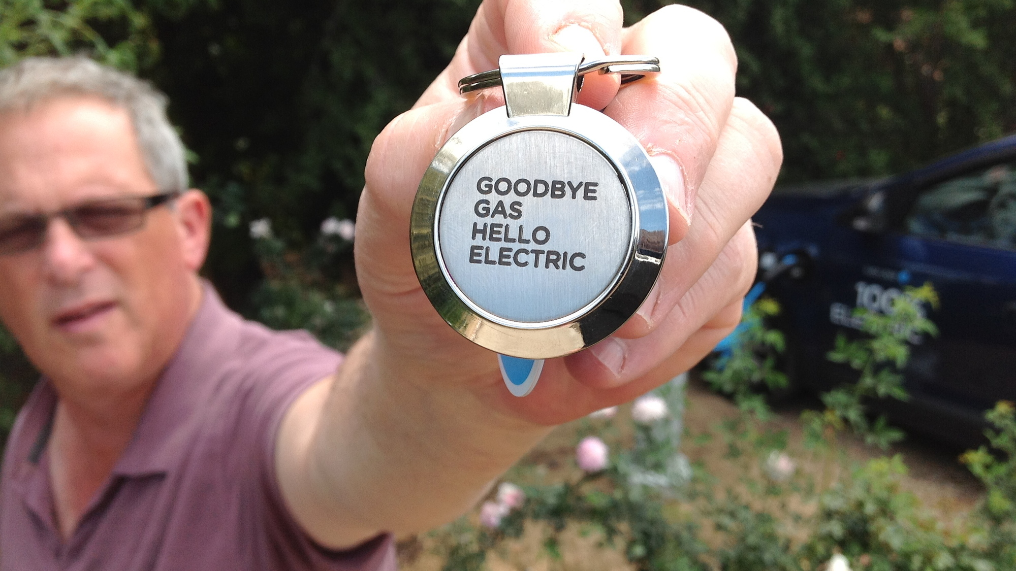 Better Place user David Rose w/keys to Renault Fluence ZE electric car in Israel [photo: David Rose]