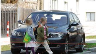 Pedestrians: Small children walking across an intersection