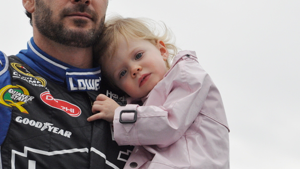 Jimmie Johnson with his daughter during Daytona 500 driver introductions - Anne Proffit photo