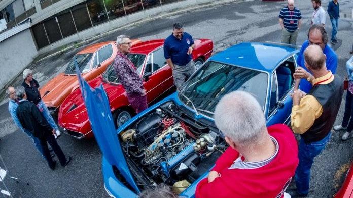 Car club members take a close look at an Alfa Romeo  | Alfa Romeo Owners Club photo
