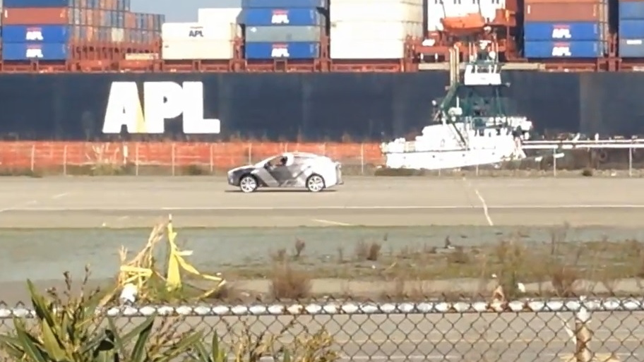 Tesla Model X in camouflage being tested at former Alameda Naval Air Station  [video: Juan del Real]