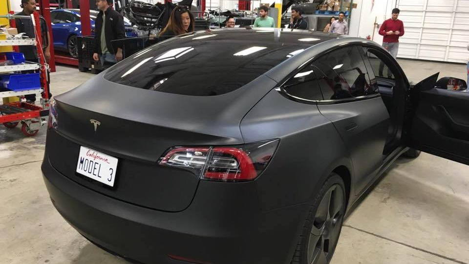 Tesla Model 3 spotted at service center