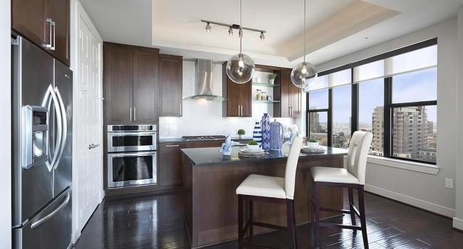 Beautiful open kitchen. Custom kitchen Cabinets, designer tile backsplash Stainless steel appliance package, Premium granite counte rtops.