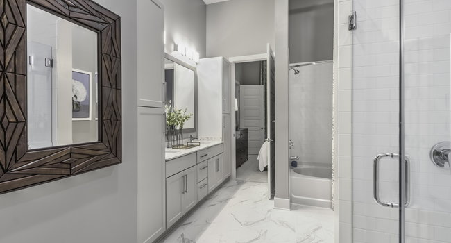 Luxurious bathrooms with walk-in showers and soaking tubs